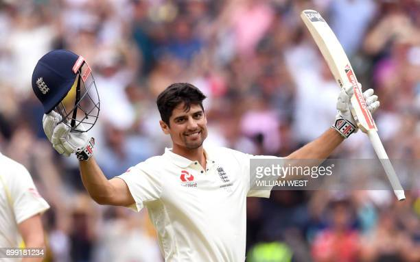 England's batsman Alastair Cook celebrates scoring his double century against Australia on the third day of the fourth Ashes cricket Test match at...