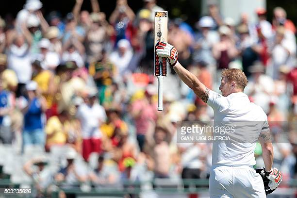 England's batsman Benjamin Stokes holds up his bat as he celebrates scoring a century during the day two of the second Test match between England and...