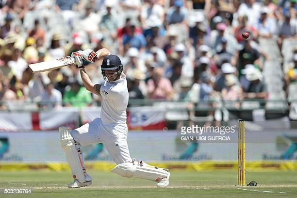 England's batsman Benjamin Stokes plays a shot during the day two of the second Test match between England and South Africa at Newlands stadium on...