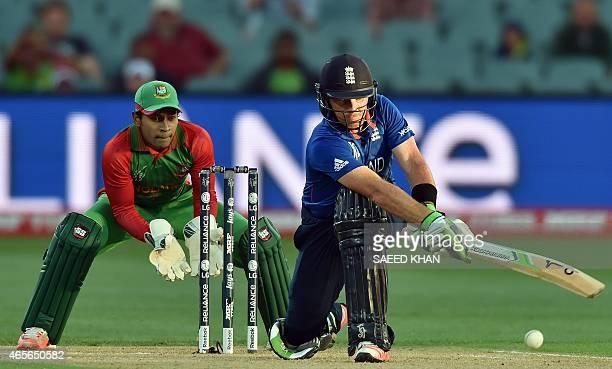 England's batsman Ian Bell plays a shot as Bangladesh wicketkeeper Mushfiqur Rahim looks on during the 2015 Cricket World Cup Pool A match between...