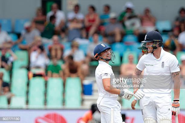 England's batsman James Taylor and Ben Stokes chat during the fourth day of the first cricket test match between England and South Africa at...