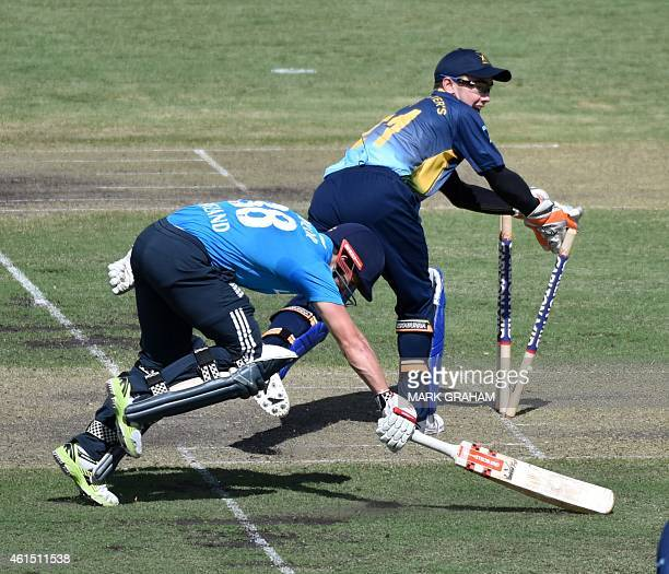 England's batsman James Taylor gets home from PM XI wicket keeper Jake Doran during a cricket tour match between England and the Prime Ministers XI...