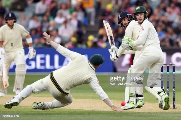 England's batsman James Vince glides a ball past Australia's fieldsman David Warner as England's batsman Joe Root and Australia's wicketkeeper Tim...