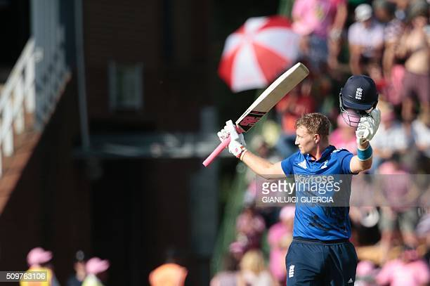 England's batsman Joe Root celebrates after scoring a century during the fourth One Day International cricket match between England and South Africa...