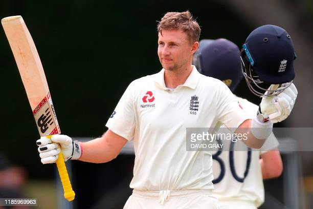 England's batsman Joe Root celebrates his double century on day four of the second cricket Test match between England and New Zealand at Seddon Park...