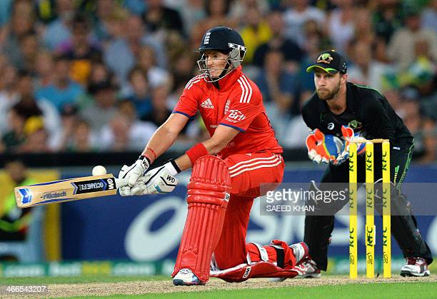 England's batsman Joe Root plays a reverse sweep shot as Australia's wicketkeeper Matthew Wade looks on during the third cricket T20 international...