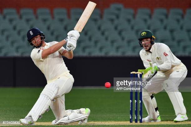 England's batsman Jonny Bairstow plays a shot as Cricket Australia XI's wicketkeeper Tim Paine looks on during the third day of a fourday Ashes tour...