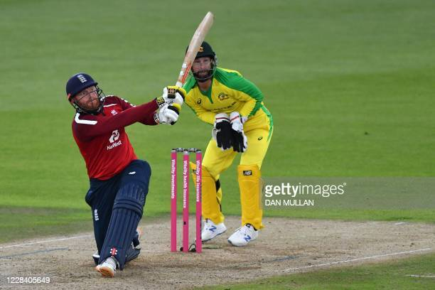 England's batsman Jonny Bairstow plays a shot in front of Australia's wicket keeper Matthew Wade during the international Twenty20 cricket match...