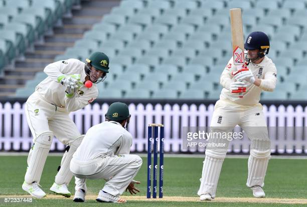 England's batsman Mark Stoneman looks back as Cricket Australia XI wicketkeeper Tim Paine collects the ball on the third day of a fourday Ashes tour...