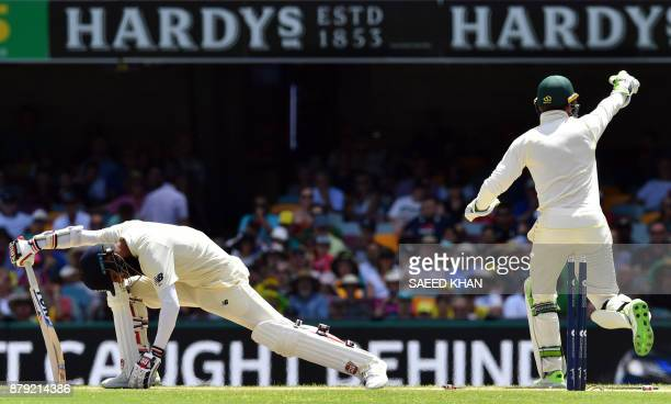 England's batsman Moeen Ali is stumped by Australia's wicketkeeper Tim Paine off the spin of bowler Nathan Lyon on the fourth day of the first...