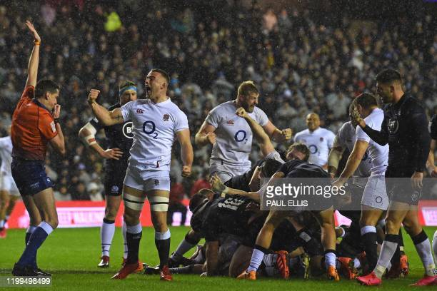England's Ben Earl celebrates as England score their first try during the Six Nations international rugby union match between Scotland and England at...