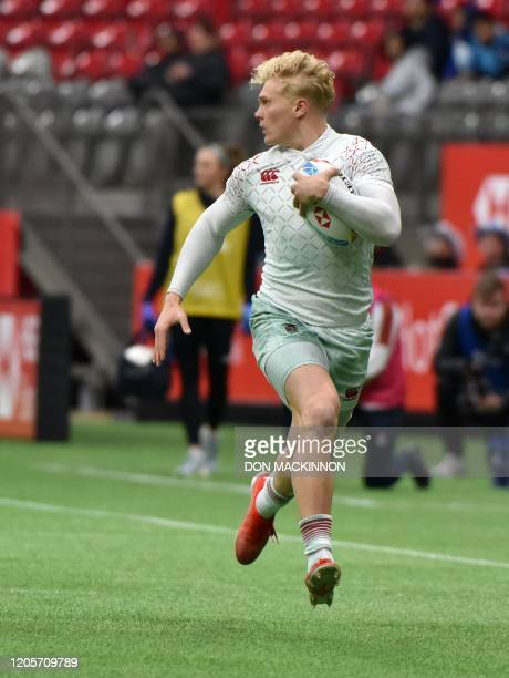 England's Ben Harris runs with the ball during the HSBC World Rugby Sevens Series match against Argentina at BC Place stadium in Vancouver, British...