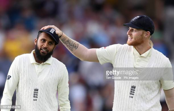 England's Ben Stokes and Adil Rashid celebrate as they walk off at the end of play during day one of the Specsavers Third Test match at Trent Bridge...