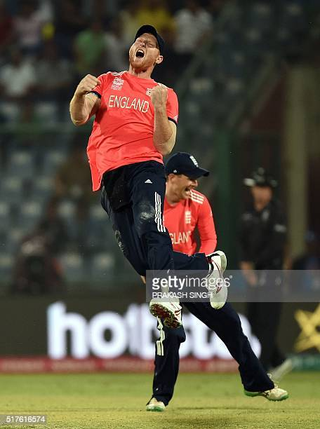 England's Ben Stokes and captain Eoin Morgan celebrate the runout of unseen Sri Lankan Lahiru Thirimanne during the World T20 cricket tournament...