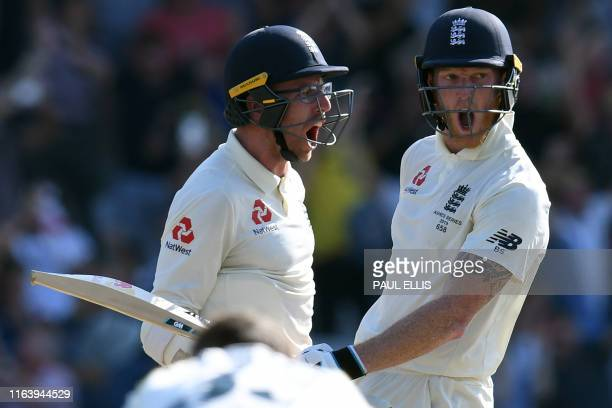 England's Ben Stokes and England's Jack Leach react after winning the third Ashes cricket Test match between England and Australia at Headingley in...