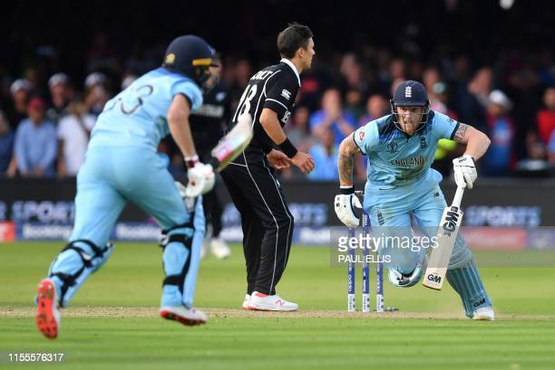 England's Ben Stokes and England's Jos Buttler add runs in the 'super over' during the 2019 Cricket World Cup final between England and New Zealand...