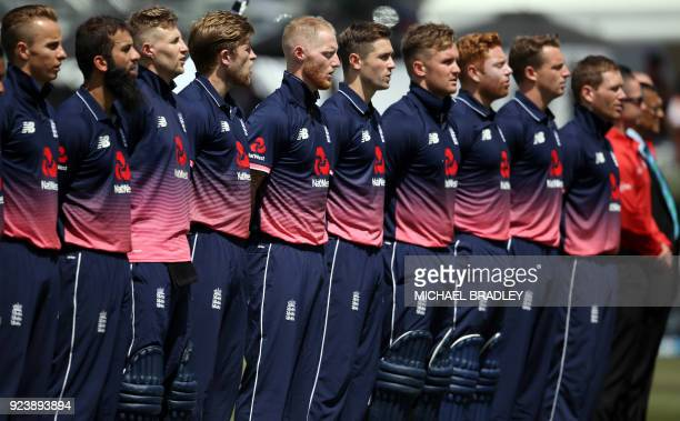 England's Ben Stokes and teammates sing the national anthem during the first oneday international cricket match between New Zealand and England at...