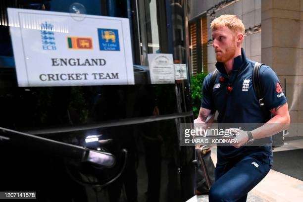 England's Ben Stokes boards a bus for the airport in Colombo on March 14, 2020. - England's cricket team abruptly pulled out of a tour of Sri Lanka...