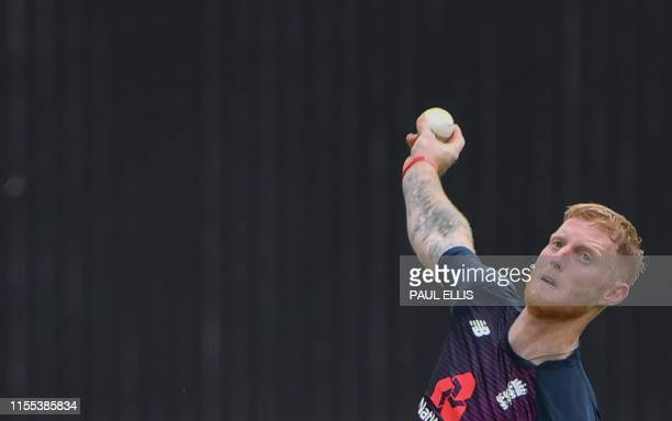 England's Ben Stokes bowls as he takes part in a training session at Lord's Cricket Ground in London on July 13 ahead of the 2019 Cricket World Cup...