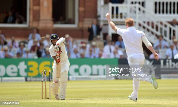 England's Ben Stokes bowls out India's Cheteshwar Pujara during day one of the second test at Lord's Cricket Ground London