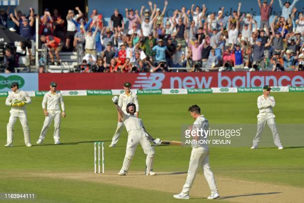 England's Ben Stokes celebrates after hitting the winning runs on the fourth day of the third Ashes cricket Test match between England and Australia...