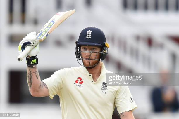 England's Ben Stokes celebrates after scoring a half century during the second day of the third international Test match between England and West...