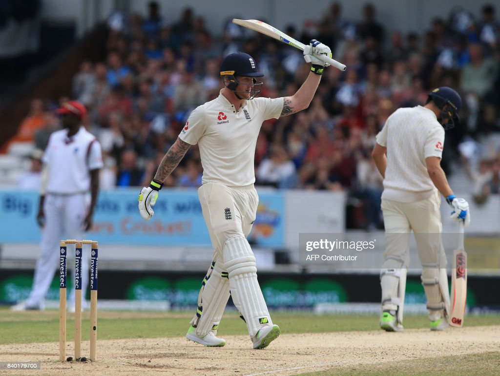 England's Ben Stokes celebrates his half century on the fourth day of the second international Test match between England and the West Indies at Headingley cricket ground in Leeds, northern England, August 28, 2017. / AFP PHOTO / Lindsey Parnaby / RESTRICTED