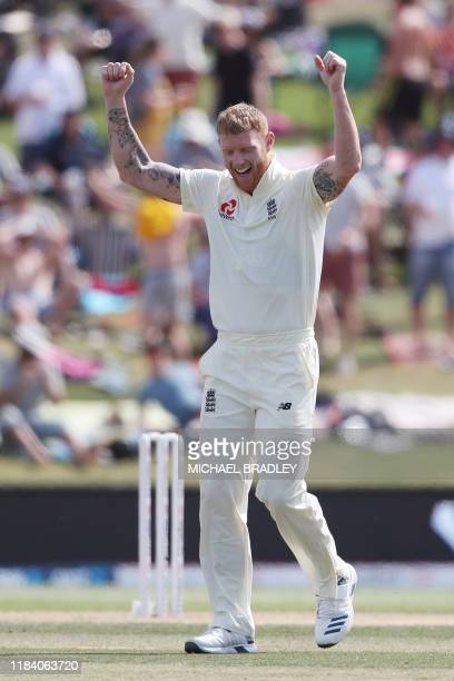 Englands Ben Stokes celebrates the wicket of New Zealands Colin de Grandhomme during the third day of the first Test cricket match between England...