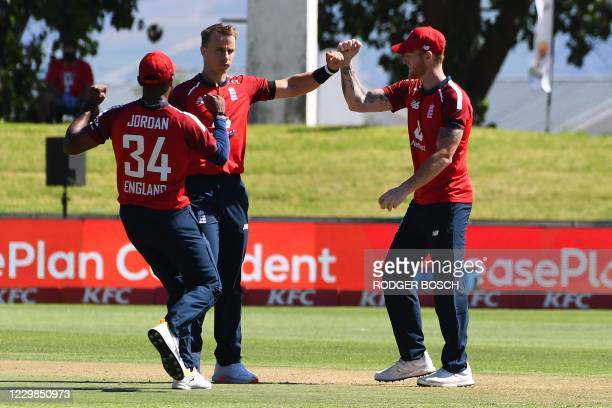 England's Ben Stokes celebrates with teammates after catching out South Africa's Heinrich Klaasen from a ball delivered by England's Tom Curran...
