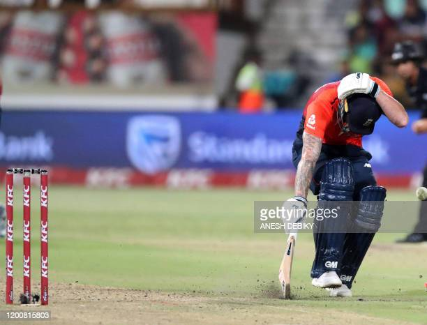 England's Ben Stokes covers his head after being hit by a ball during the second Twenty20 international cricket match between South Africa and...