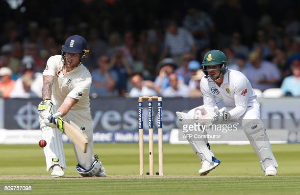 Englands Ben Stokes hits a shot watched by South Africas wicketkeeper Quinton de Kock on the first day of the first Test match between England and...