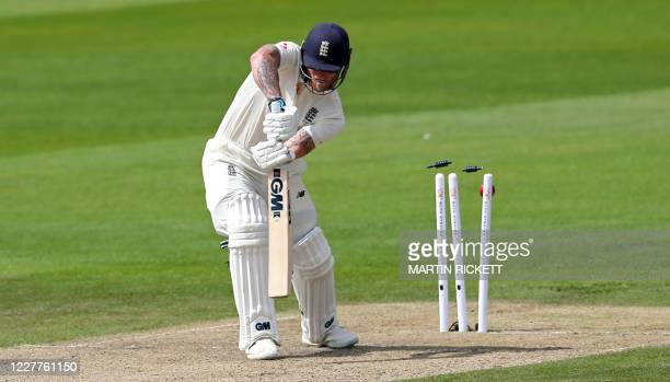 England's Ben Stokes is clean bowled by West Indies' Kemar Roach for 20 on the first day of the third Test cricket match between England and the West...