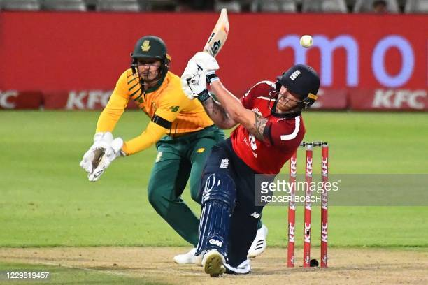 England's Ben Stokes misses a shot as South Africa's captain Quinton de Kock reacts during the first T20 international cricket match between South...