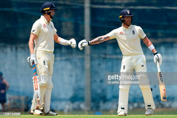 England's Ben Stokes prepares to pat the hand of his teammate Zak Crawley during the third day of a threeday practice match between Sri Lanka Cricket...