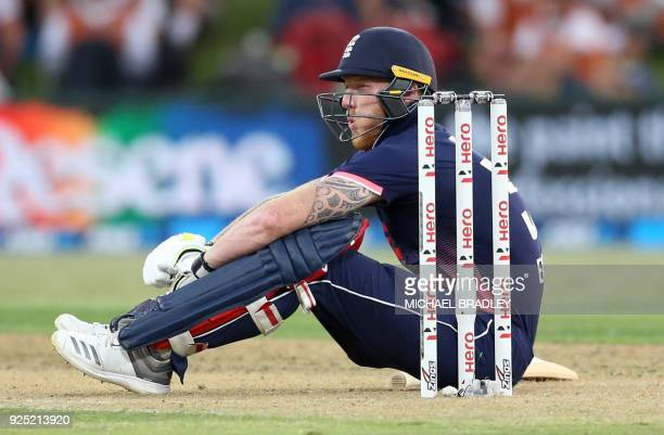 England's Ben Stokes reacts after being hit by the ball during the second oneday international cricket match between New Zealand and England at the...