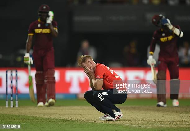England's Ben Stokes reacts after being hit for consecutive sixes in the World T20 cricket tournament final match between England and West Indies at...