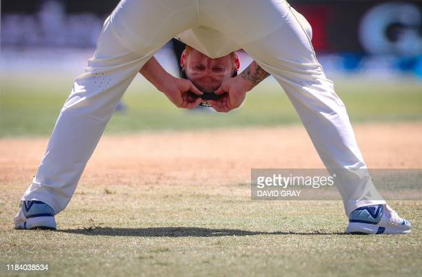 England's Ben Stokes reacts after dropping a catch from New Zealand's BJ Watling during the third day of the first cricket Test between England and...