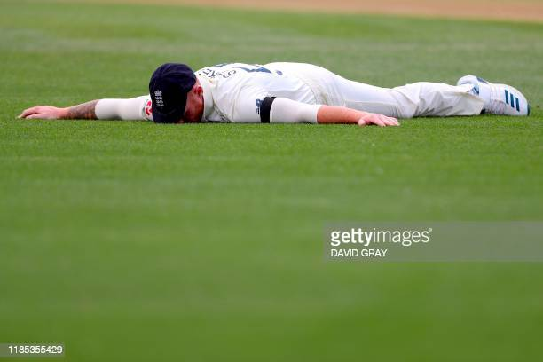 TOPSHOT England's Ben Stokes reacts after dropping a catch from New Zealand's Tom Latham on day one of the second cricket Test between England and...