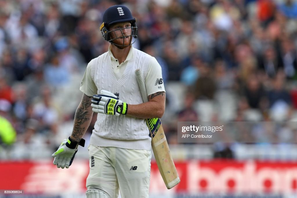 England's Ben Stokes reacts as he walks back to the pavilion after losing his wicket during play on day 2 of the first Test cricket match between England and the West Indies at Edgbaston in Birmingham, central England on August 18, 2017. / AFP PHOTO / Paul ELLIS / RESTRICTED