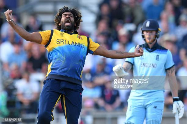 TOPSHOT England's Ben Stokes reacts as Sri Lanka's Lasith Malinga celebrates taking the wicket of England's Jos Buttler for 10 runs during the 2019...