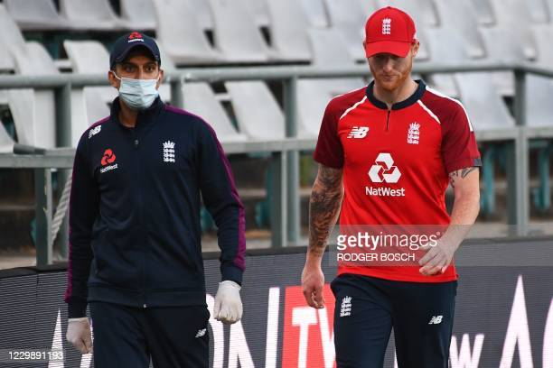 England's Ben Stokes walks off the field after receiving medical attention for his injured hand during the third T20 international cricket match...