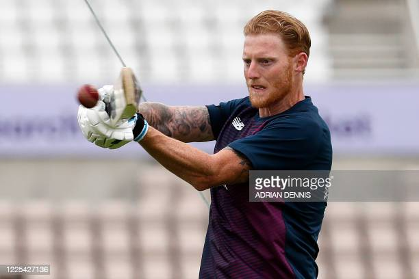 England's Ben Stokes warms up ahead of play on the first day of the first Test cricket match between England and the West Indies at the Ageas Bowl in...