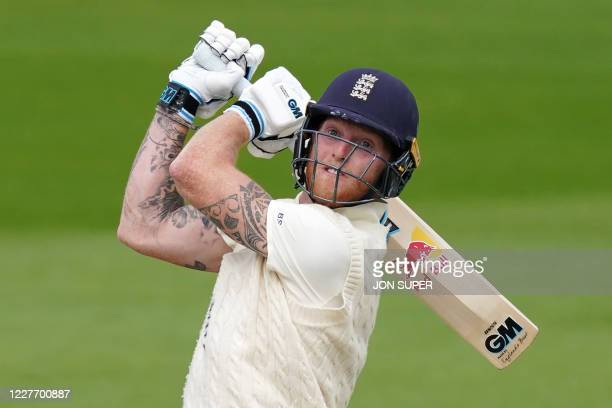 England's Ben Stokes watches his shot clear the boundary for six during play on the final day of the second Test cricket match between England and...