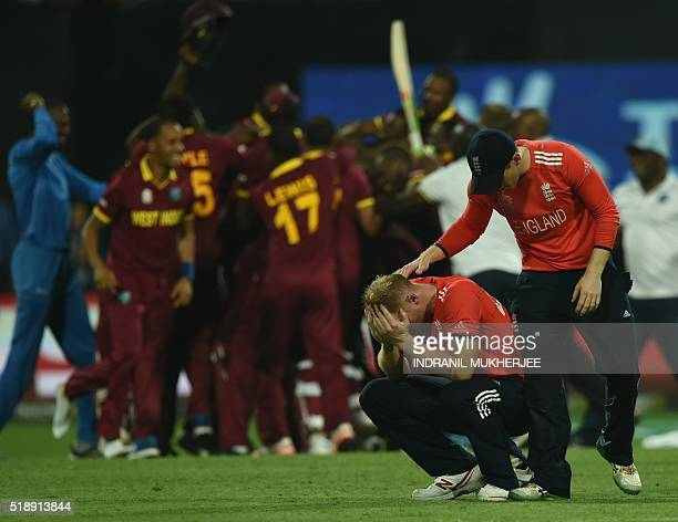 TOPSHOT England's Ben Stokesis consoled by team captain Eoin Morgan after losing the World T20 cricket tournament final match between England and...