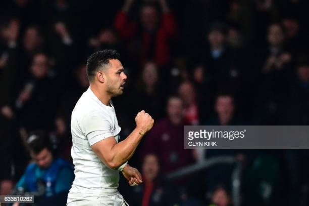 England's Ben Te'o celebrates after scoring England's first try during the Six Nations international rugby union match between England and France at...