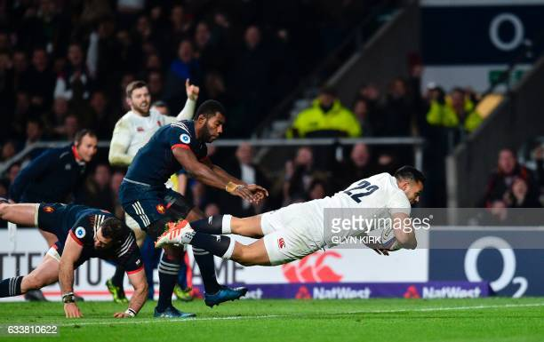England's Ben Te'o dives over the line to score a try during the Six Nations international rugby union match between England and France at Twickenham...