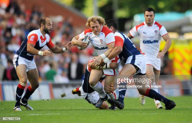 England's Ben Westwood is tackled by France's Nicholas Munoz, Sebastien Raguin and Jamal Fakir during the international match at Leigh Sports...