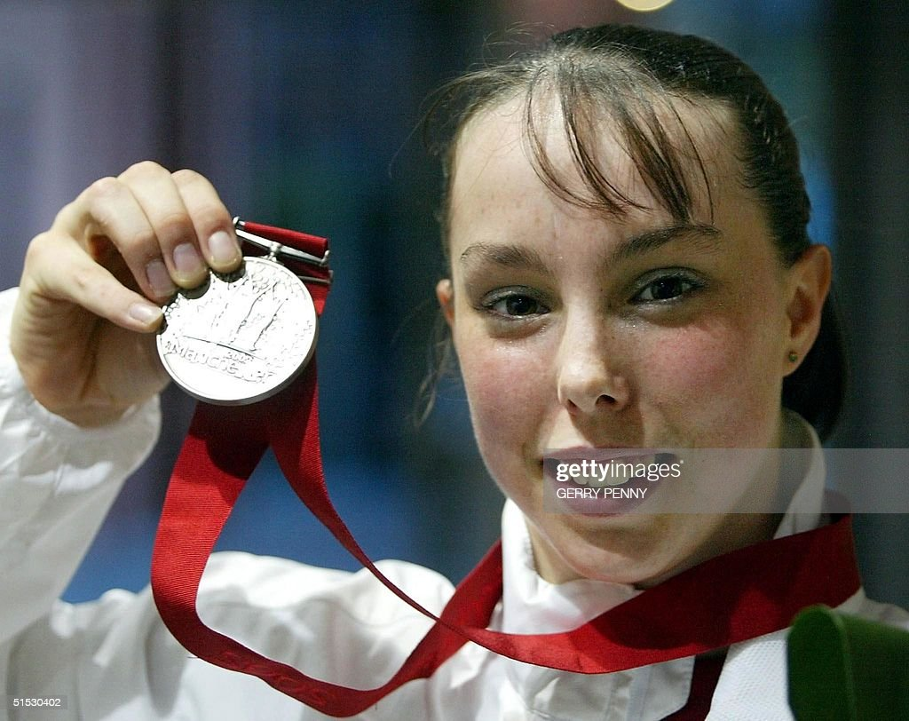 England's Beth Tweddle proudly holds her silver me : News Photo