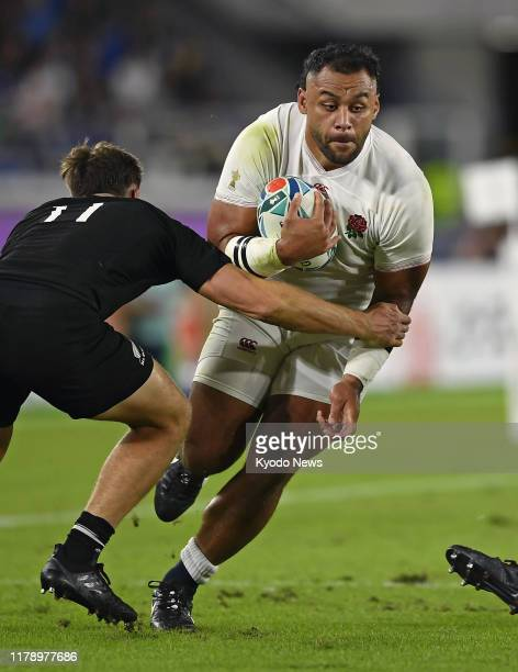 England's Billy Vunipola takes on George Bridge of New Zealand in a Rugby World Cup semifinal on Oct 26 in Yokohama near Tokyo
