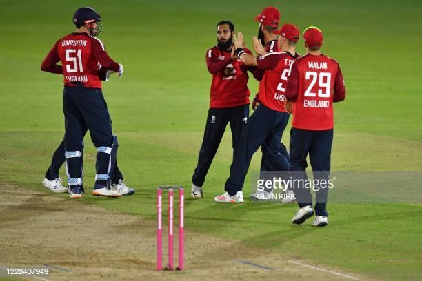 England's bowler Adil Rashid celebrates taking the wicket of Australia's batsman Steve Smith during the international Twenty20 cricket match between...